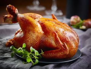 46728179 - roasted chicken on gray plate